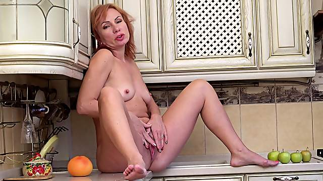 Horny old broad Silvia rubs one out in her upscale kitchen